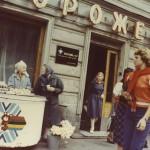 Babushkas selling daisies from an ice cream cart. Leningrad, 1982