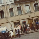 A line for kvas, a soft drink made from bread (the vendor rinses the same mug for everyone on the line). Leningrad, 1982