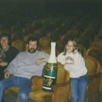 With my husband and daughter Laurenka in the Comedy Theatre in St. Petersburg (the theatre where my sister Marina acted). The champagne bottle is a play prop. 1998